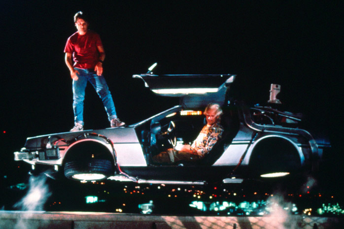 MIchael J Fox standing on the floating DeLorean