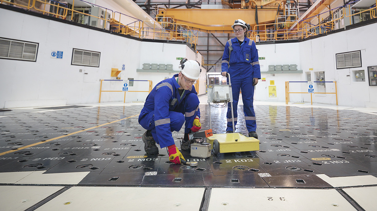 Male and Female engineers measuring radiation