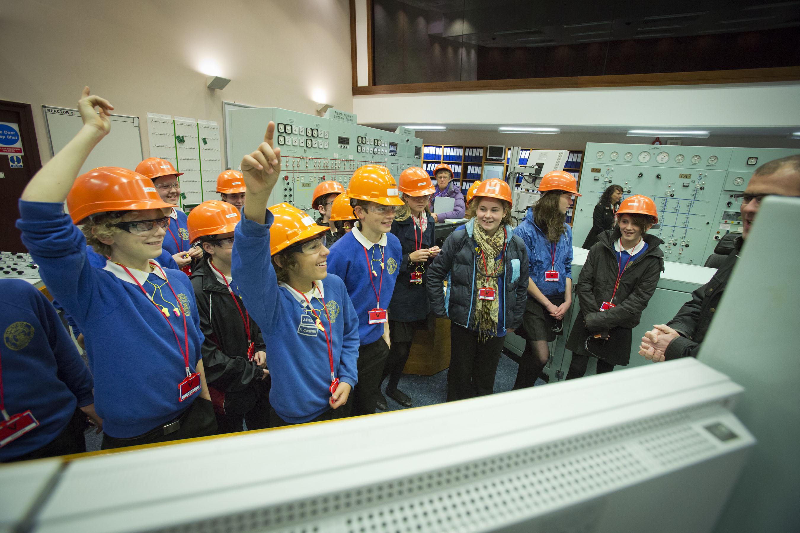 Schoolchildren in hard hats during a power station tour