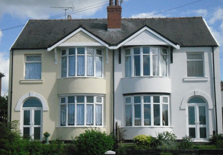 Example of a pair of semi-detached houses with solid external wall insulation and render