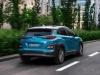 Hyundai Kona Electric rear view on road