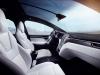 Tesla Model X interior view seating panoramic roof dashboard