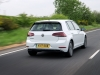 VW e-Golf rear view driving on road