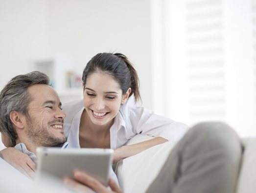 Couple looking at a laptop together