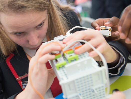 School girl examining computer server
