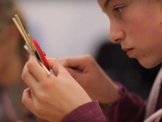 School pupils studies a wooden structure