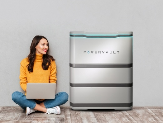 Lady with laptop next to Powervault