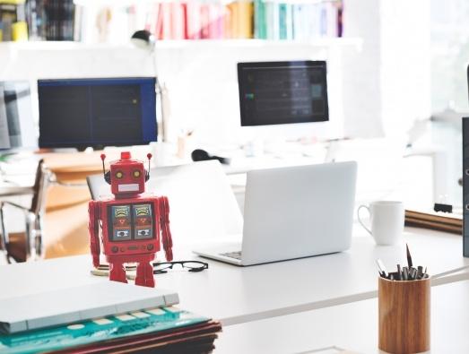 Robot next to a laptop