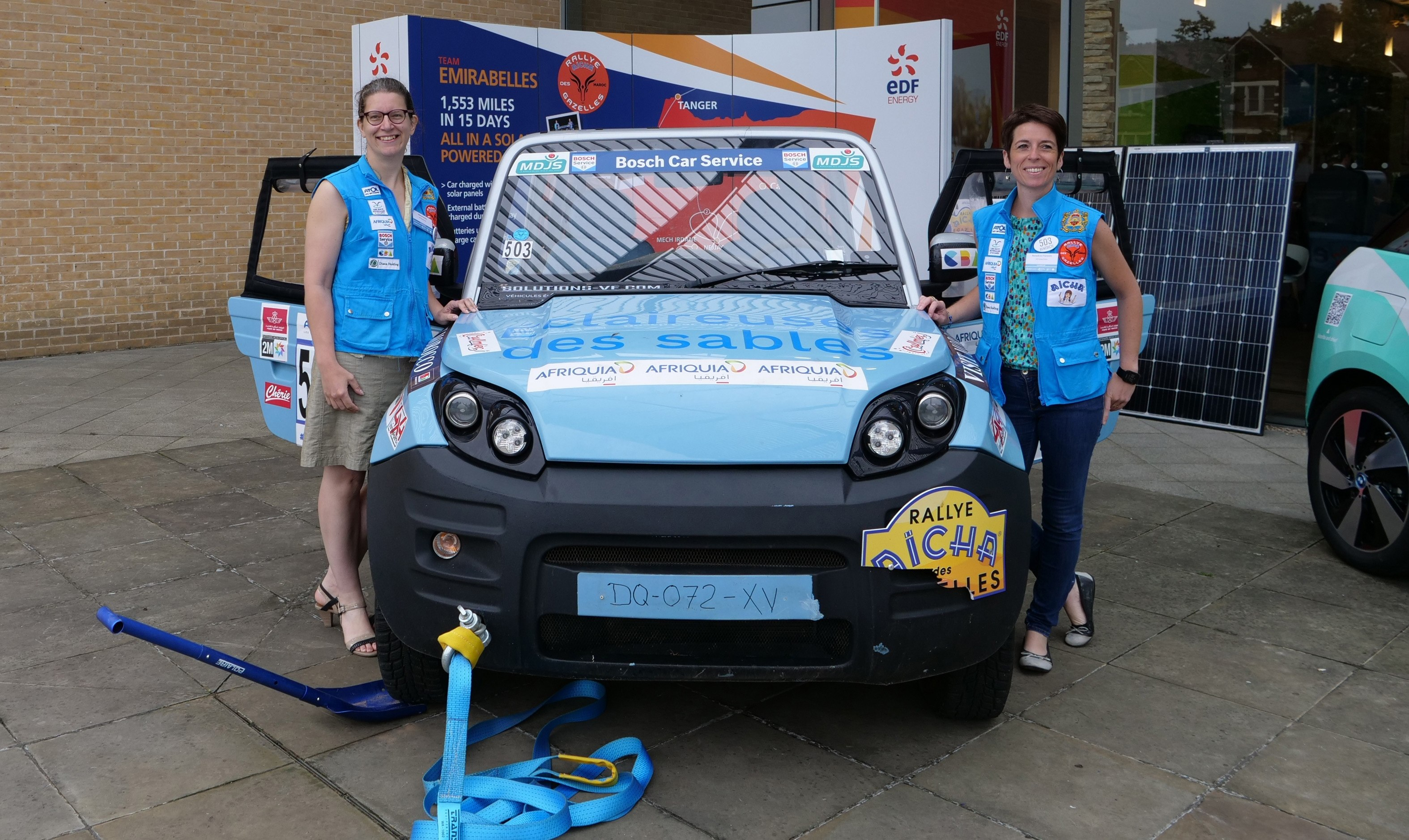 """The Emirabelles showing off their solar powered 4x4 from the """"rallye des Gazelles"""" at the Oxford EV Summit."""