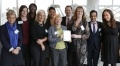 Representatives from EDF Energy's employee networks and its D&I team receive the National Equality Standard award, pictured with Arun Batra (CEO) and Jo Heath from NES