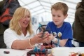 Getting to grips with circuits is Hinkley Point C's Lidia Bosa and young visitor Matt Kidd.