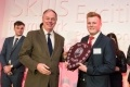 EDF Energy chief executive Vincent de Rivaz presents Joe Dickinson, 22, Heysham 1 power station in Lancashire with apprentice of the year
