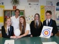 L-R Sophie Brown, Erin Hill, Daisy Evans and Stephen Mainds meet Eve Muirhead at Ross High for a lesson on sport and STEM