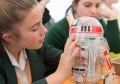 A student from Southend High School for Girls builds a Droid at EDF Energy Pretty Curious event at Kent Showground