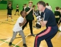 Hinkley Point B Station Director Peter Evans helps coach Bridgwater pupils.