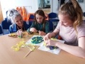Dungeness B tour guide, Lesley Clancy oversees an Easter themed activity with Rubie-Rose Slade, 8, and Lucie Delea, 14