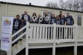EDF Energy East Kilbride volunteers outside one of the caravans they cleaned for Glasgow Children's Holiday Scheme. They also handed over a cheque for £8,000 pounds.