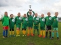 Lydd Grasshoppers under 9's lift their trophy in recognition of their successful season
