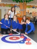Pupils from Berwick Middle School with Scottish curling captain Eve Muirhead during theTorness power station Christmas Cracker week.