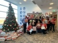Staff from EDF Energy's East Kilbride office and South Lanarkshire Council's Social Work Department at the Christmas Giving Tree gift handover.