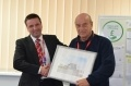 Ian Harris receives his framed picture of Dungeness from the Office of Nuclear Regulation's Donald Urqhart