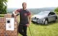Ore Oduba charging an electric car