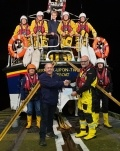 Lifeboat volunteer and Torness security team member, John Campbell, presenting the cheque to members of the Berwick Upon Tweed lifeboat crew