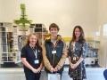 L-R: Faith Scott (Visitor Centre Co-ordinator), Rian Cook (30,000th visitor), Cris Martinez (HR Manager).