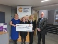 L-R: Odette Landsburgh, Louise Graham and Sandra McCall from Ayrshire Cancer Support with Hunterston B Station Director, Paul Forrest