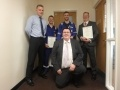 Hinkley Point B Station Director, Peter Evans presenting the Royal Humane Society resuscitation certificates to (Left to right) Aaron Tyrrell, Connor Keirle and Mark Williams. (front) Ross Perkins.