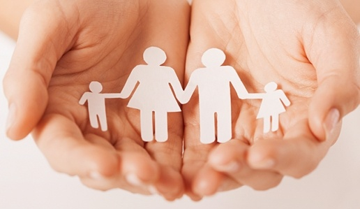 Priority Services Support - Hands holding paper cut-out family