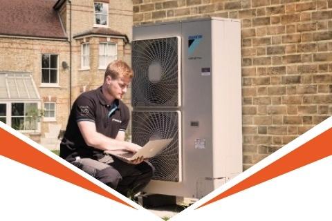 Daikin engineer installing an air source heat pump
