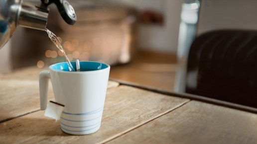 Pouring a cup of tea from a hot kettle