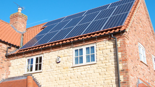 solar panels installed on the roof of a brick building