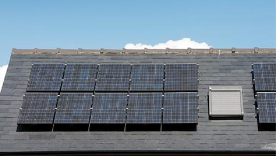 solar panels installed next to a skylight