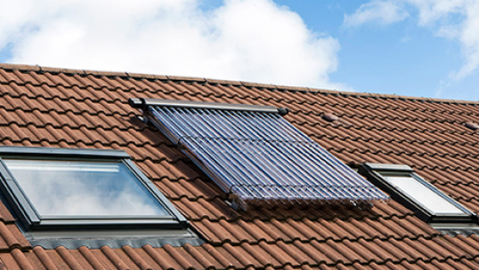 a solar thermal panel installed between skylights