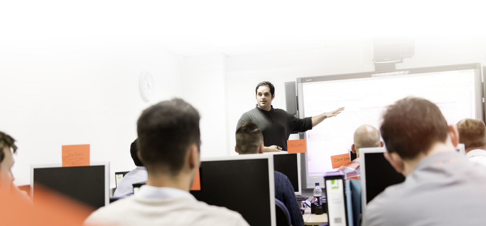 Man presenting in a training session inside a training room