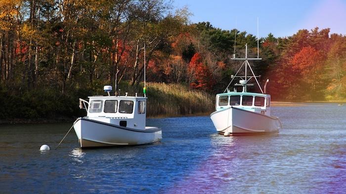 Two boats on a river near Heysham