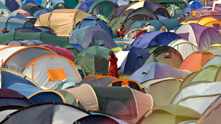 Picture of tents in a field near Hinkley Point power station