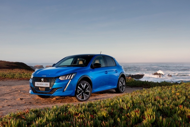 Peugeot e-208 GT in Blue on beach