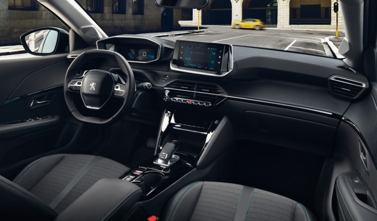 Peugeot e-208 GT in blue interior