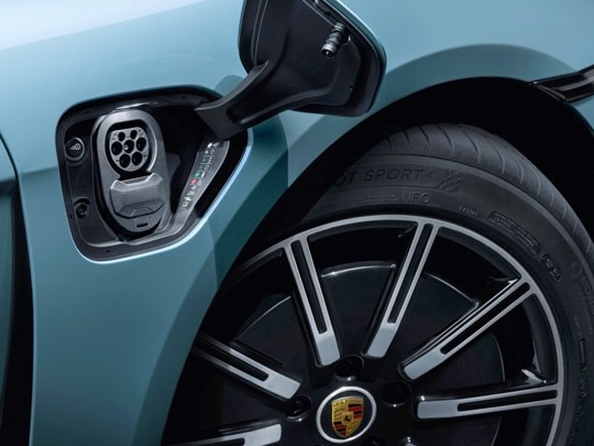 Porsche Taycan charge port in blue