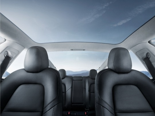 Tesla Model 3 interior view seating panoramic roof