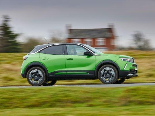 Vauxhall Mokka-e in green side shot