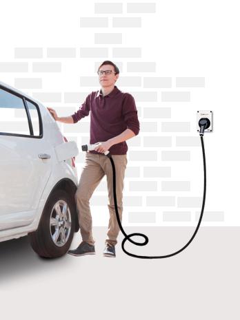 Man charging his electric car
