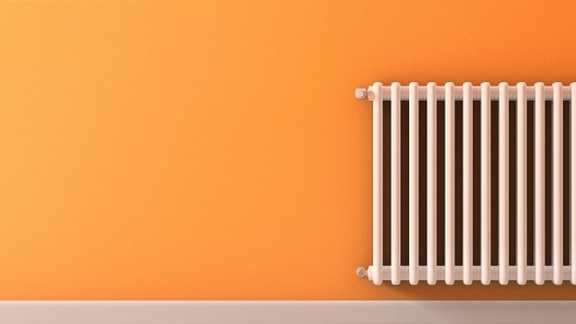 Radiator on orange wall