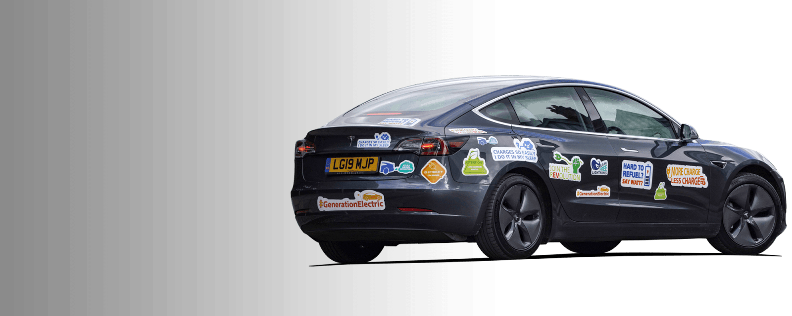 Tesla covered in bumper stickers