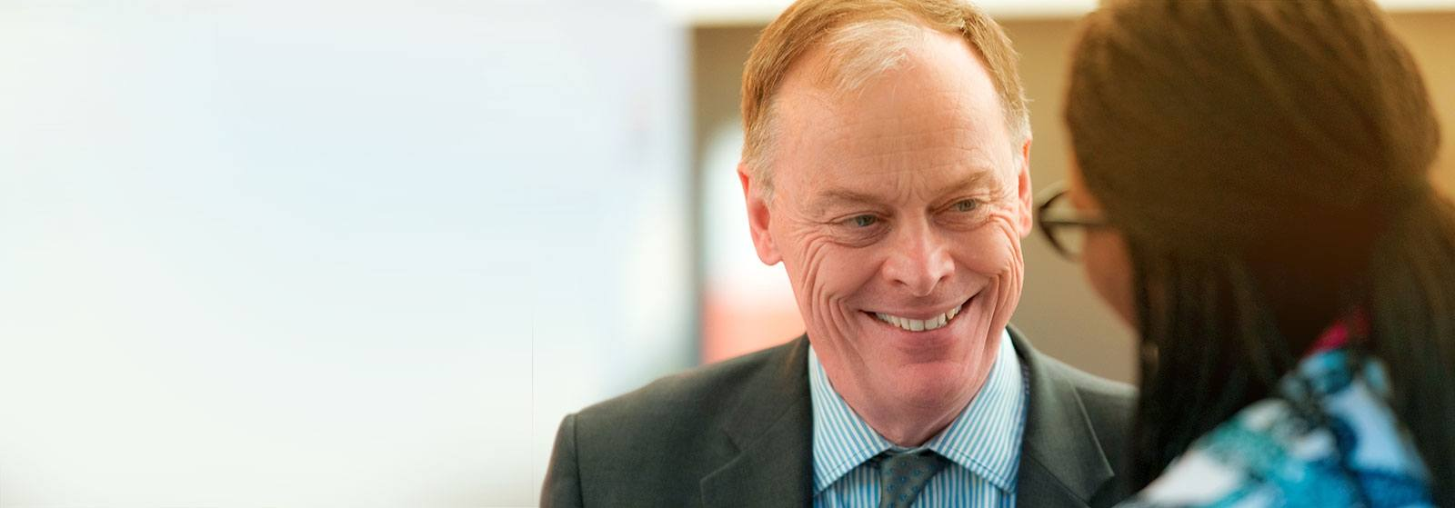 EDF Energy's CEO, Vincent de Rivaz in conversation with a lady