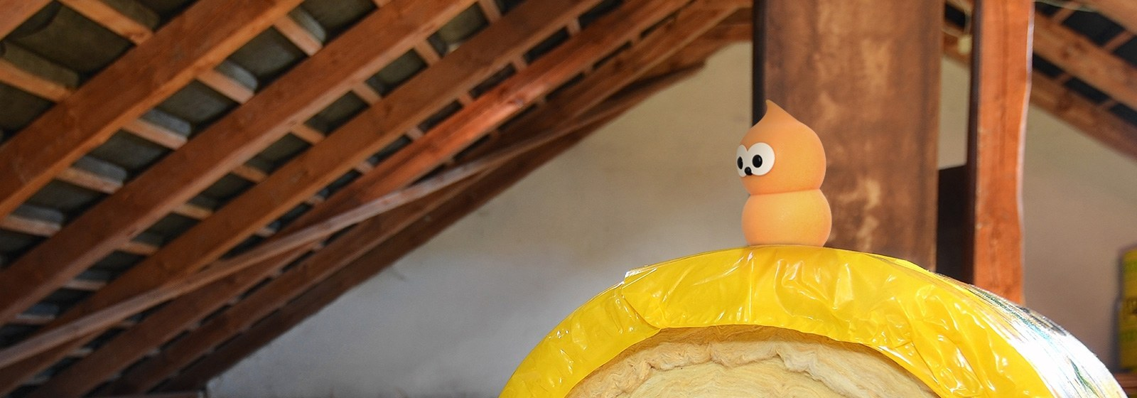 Zingy Sitting On Roll Of Loft Insulation In A Loft