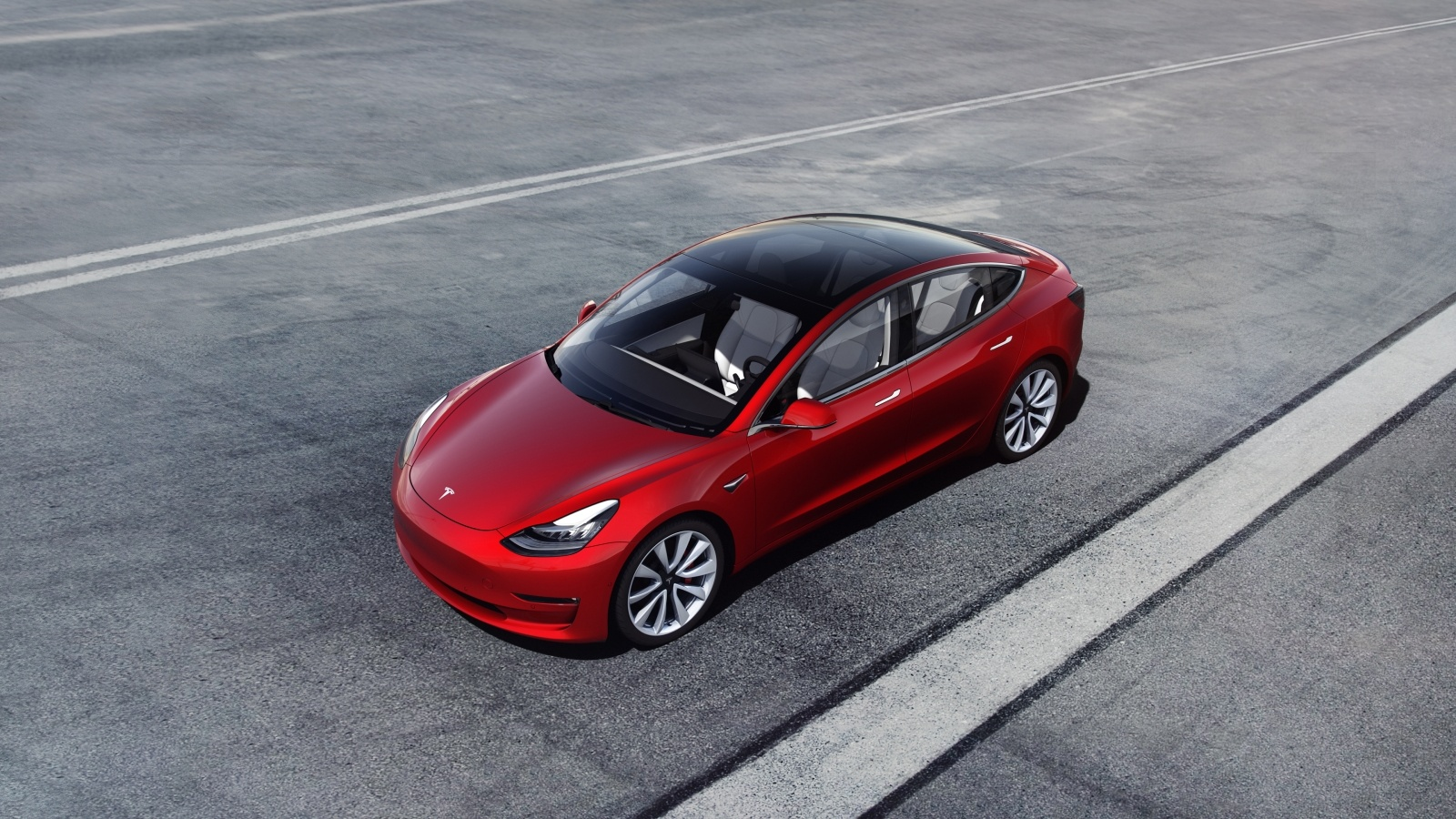 Tesla Model 3 in red aerial view